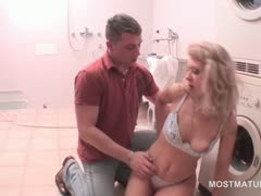 blonde-mature-gets-cunt-fingered-while-sucking-a-vibrator