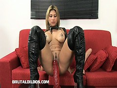 busty blonde fills her mouth and pussy with big dildos