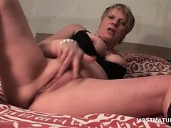 mature-tramp-in-leather-boots-finger-fucking-herself-deep