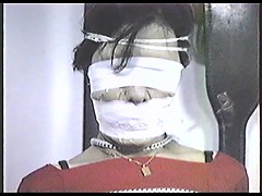poletied-and-tightly-tape-gagged