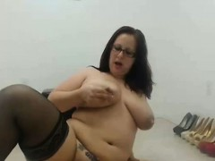 bbw-in-glasses-riding-a-toy-in-front-of-her-web-cam