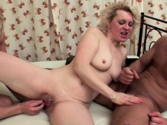 blonde-grandma-jizzed-by-two-guys