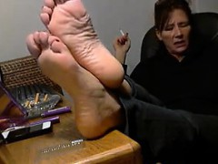 mom-showing-off-her-feet-and-smokes