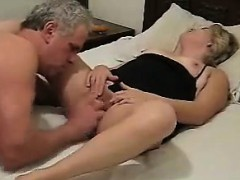 mature-couple-having-fun-in-bed-with-a-dildo