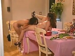 lesbians-having-fun-on-a-dinner-table