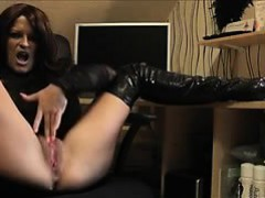 mature-brunette-in-boots-fingering-herself