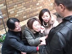 japanese-women-tease-man-in-public-via-handjob-subtitled