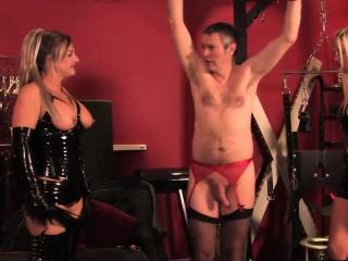 Latex flogging action with three brit femdoms
