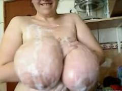 milf-puts-foam-on-her-huge-tits-in-kitchen