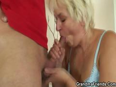 blonde-granny-takes-two-cocks