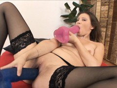 brunette sucks on a big dildo as another gapes her wet twat