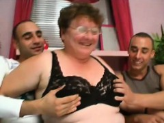 foxy-granny-gets-hammered-by-two-young-shafts