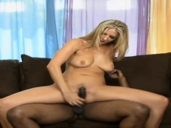 elegant blonde with a sexy butt impales herself on a massive black shaft sexy