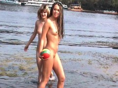 playful young vixens engage in naked watersports on the bea