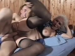slutty-mature-woman-in-black-stockings-gets-banged-deep-by-a-young-man