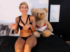 hot blonde amazon in sweet black lingerie plays with a teddy