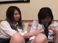 two-naughty-asian-schoolgirls-open-their-blouses-to-play-wi