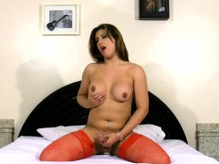 chubby-shebabe-in-red-stocking-plays-with-shecock-on-the-bed