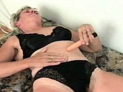 horny-granny-pleases-herself