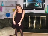 Charming chick in black hose drills her twat with a toy