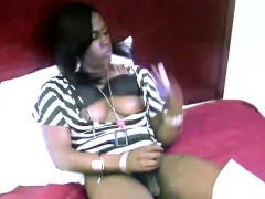 Sexy Brown Skinned Tranny Shows Fat Black Ass And Tugs Off