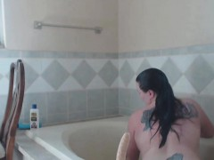 busty-mature-fucks-dildo-in-hot-tub-and-showers