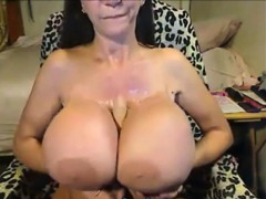 mature with big silicone tits masturbates