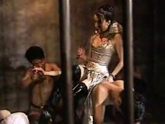 sex-slaves-in-a-cage-are-taken-out-and-tortured-by-a-domina