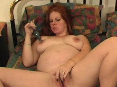 hot-redhead-milf-plays-with-her-sex-toy
