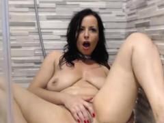 cute-big-tits-milf-toys-herself-on-webcam
