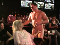 Hawt stripper is getting his penis sucked by several chicks
