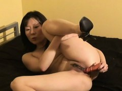 asian-wife-wears-only-heels-while-toying-her-trimmed-twat
