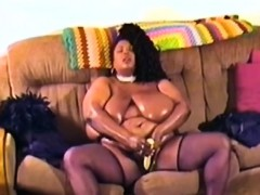 Fat African chick using dildo for masturbating