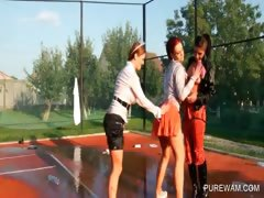 three-clothed-lesbos-gets-wet-and-messy-on-tennis-field