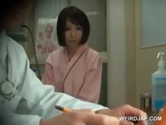 redhead-asian-beauty-gets-boobs-checked-at-doctor