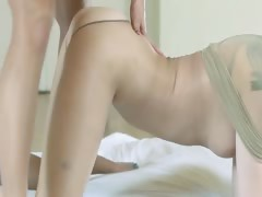 smart-young-girls-with-strapon-on-bed