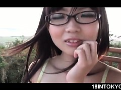 jap-teen-in-glasses-flashing-sexy-assets-in-small-swim-suit