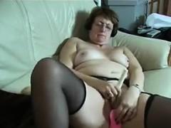 Horny Granny Masturbates With Adult Toys