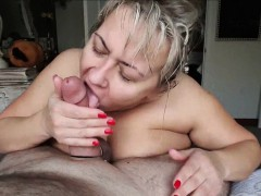 Mature BBW gives a titfuck to her lover