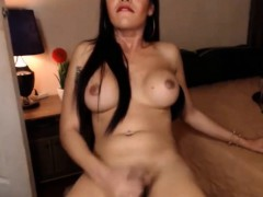 brunette-shemale-ejaculates-a-big-cumshot