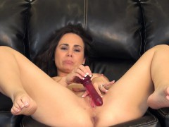 holly-west-sends-her-fingers-and-a-red-dildo-pleasing-her-aching-twat