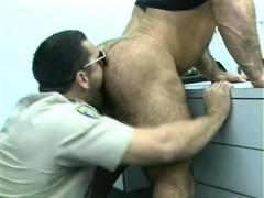 prison-guard-does-a-cavity-search-on-a-burly-inmate-with-his-tongue-and-cock
