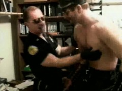 muscled-cop-and-biker-stud-cock-sucking