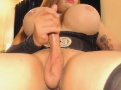 busty-shemale-with-big-cock-pleasures-on-cam