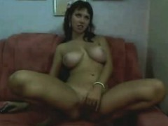 busty masturbates with her finger on the couch