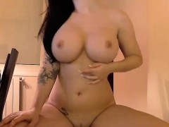 busty-brunette-puts-a-dildo-in-her-pussy-on-the-chair