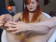 pretty redhead displays her nice pink cunt
