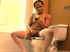 ebony-tgirl-tugging-her-cock-in-the-bathroom