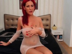 Sexy Stripteasing Redhead Babe Seduces On Webcam With Her Ho