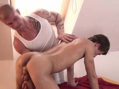 Tattooed Top Massaging A Handsome Twink
